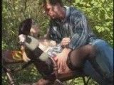 Couple fucking on a public park bench