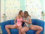 Horny lesbians making out on sofa