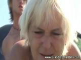 Horny granny gets cummed on