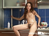Barbara plays with whip cream in her hairy pussy